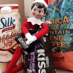 Tucker the merry elf is bringing in supplies for the festivities.